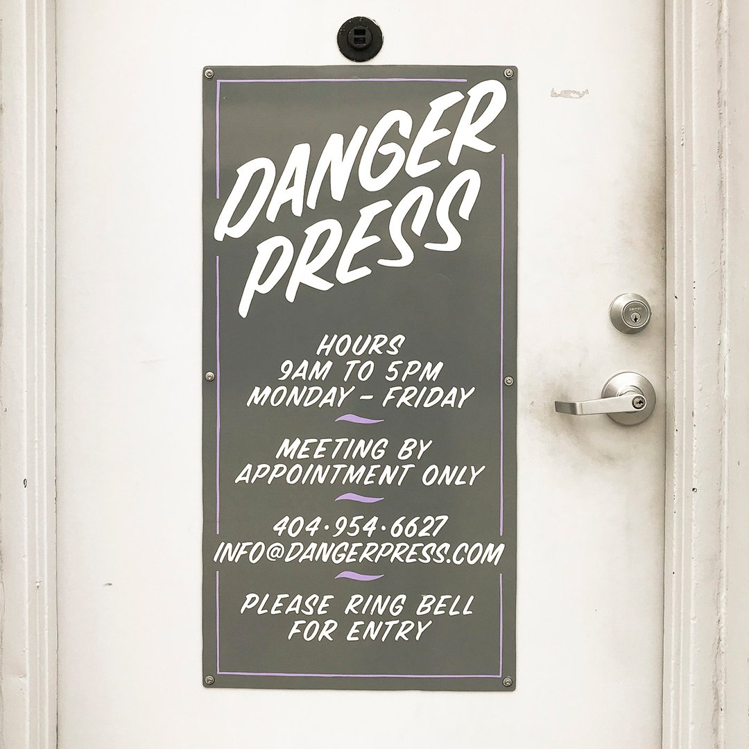 Door sign at Danger Press
