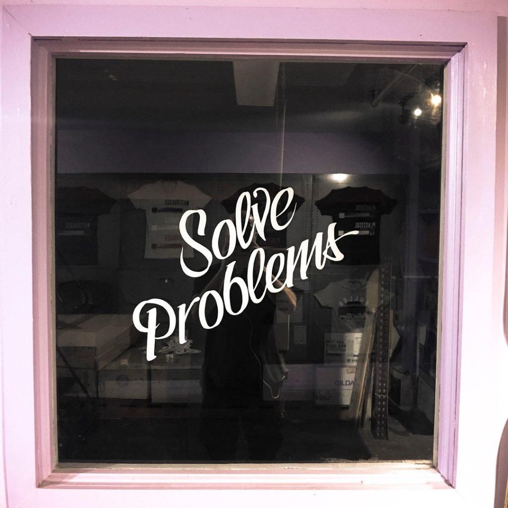 Solve Problems sign at Danger Press